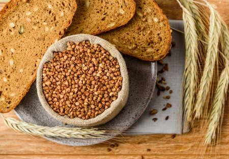 linen bag: buckwheat in a linen bag in the background grain bread