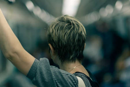 short haircut: woman with short haircut in the metro is back