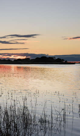 pink sunset: autumn pink sunset reflected in the lake