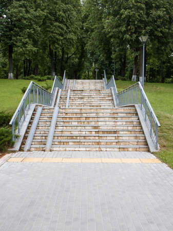 Park stairs of several tiers with a ramp and lantern