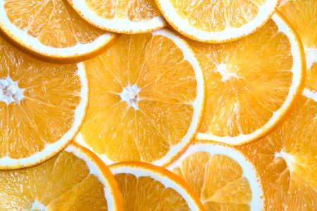Horizontal shot of sliced oranges background, bright fresh fruit cut into even slices