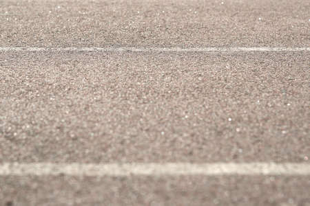 Texture of road asphalt. The foreground in the blur.