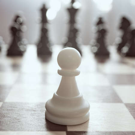 Single pawn against many enemies as a symbol of difficult unequal fight or struggle of minorities. Background in blur. Stock fotó