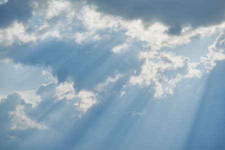 Horizontal shot of Inspirational light shining through clouds.