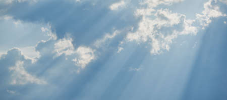 Horizontal shot of background of the sun through the clouds.