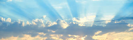 Horizontal shot of background of sun rays over clouds. Stock Photo