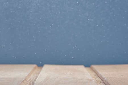 Horizontal shot of wooden surface on a blue background with bokeh in blur. Photo from copy space. Foto de archivo