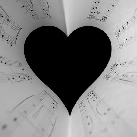 Heart music notes. The black and white concept of the love of music. Foreground soft focus.