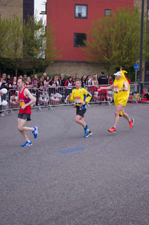 them: London, United Kingdom. 24 april, 2016. Pack of runners participating in the Virgin Money London Marathon, one of them dressed as a banana.