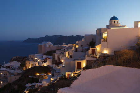 aegean: After sunset hour at Oia village of Santorini island in the .Cyclades, aegean sea, Greece.