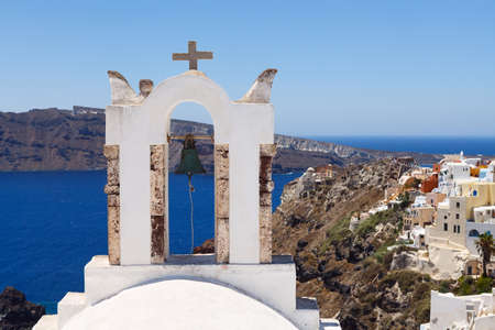 Beautiful view of famous Greek churches in the mediterranean island of Santorini. photo