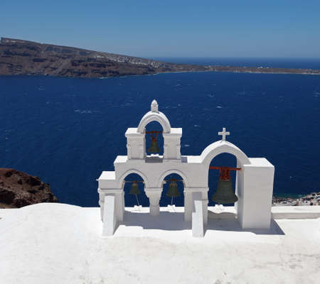 Beautiful view of famous Greek churches in the mediterranean island of Santorini  photo