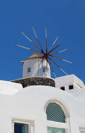 Windmill on Santorini island, Oia village, Greece photo