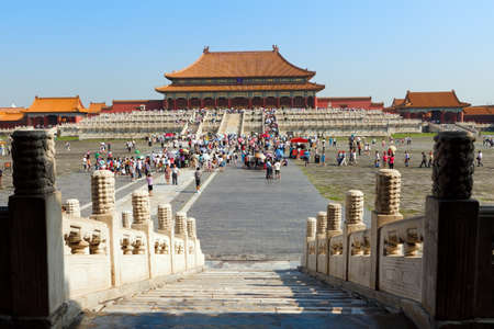 chinese temple: TIANJIN, CHINA  Tourist fill the vast grounds of the Taihedian Square inside the Forbidden City  Beijing, China  Stock Photo