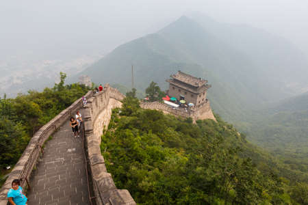 Tourist-spot at Great Wall of China under the fog