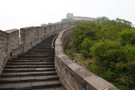 Tourist-spot at Great Wall of China under the fog photo