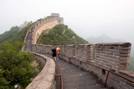 feats: The Great Wall of China in the fog  Tourist Route
