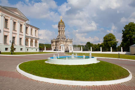 Fountain and Blessed Virgin Mary Church in Dubrovitsy  Russia photo