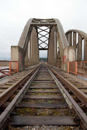 riverside county: railway bridge through Volga river In Kalyazin. Russia