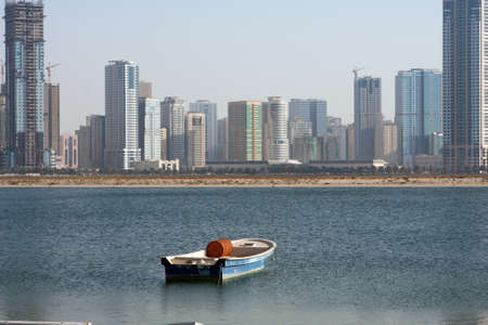 The boat and modern buildings at Sharjah photo