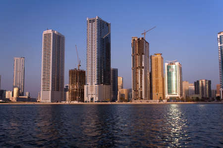 sunlit panorama of lagoon in sharjah. UAE. photo