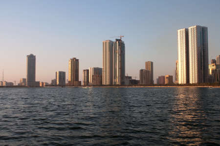 lake district: sunlit panorama of lagoon in sharjah. UAE. Stock Photo