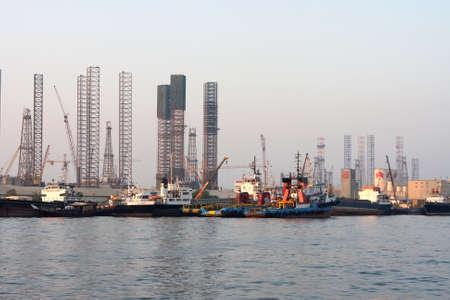 Oil rigs in the repair at the shore Sharjah United Arab Emirates