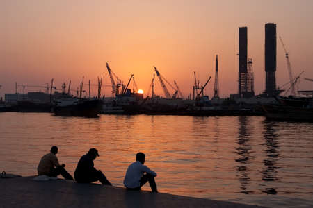 persian gulf: workers in the port Sharjah rest after a working day. UAE Stock Photo