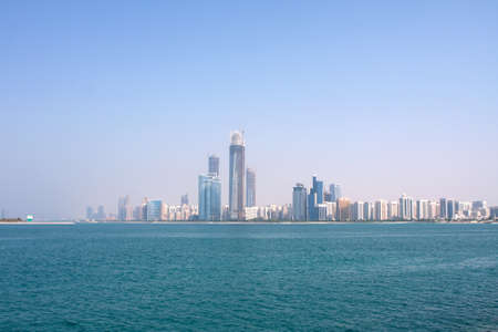 waterside: The view from the sea of the buildings and skyscrapers in Abu Dhabi downtown  Stock Photo