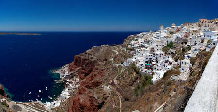 Beautiful view of Oia village in the mediterranean island of Santorini  photo