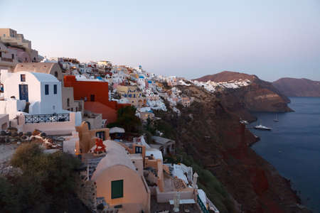 fira: Befor sunset hour at Oia village of Santorini island in the Cyclades, aegean sea, Greece. Stock Photo
