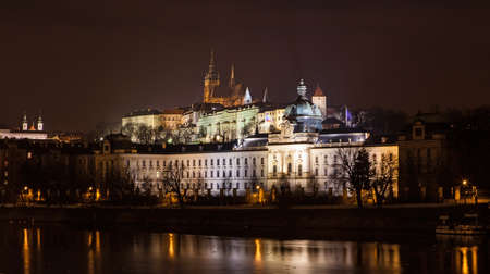 The night View on bright Prague with St. Vitus Cathedral and gothic Castle photo