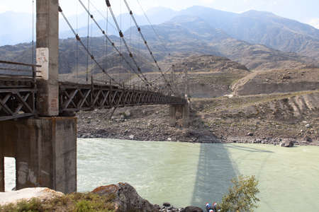 katun: Old abandoned suspension bridge over the river Katun, Altai, Russia.