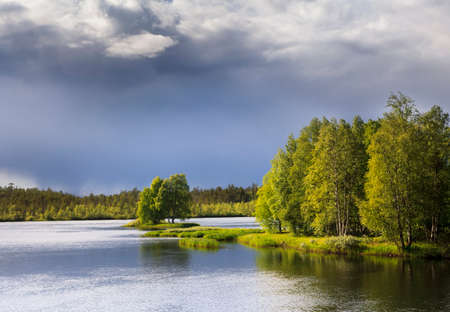 Nature of Russia. The Republic of Karelia. Islands on the horizon. Wild nature. Calm on the lake. Chirka-Kem river.