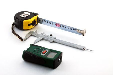 finder: Roulette, calliper and laser range finder on a white background