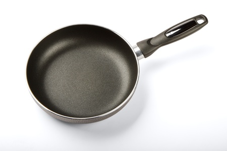 Frying pan with a teflon covering isolated on a white background Stock Photo