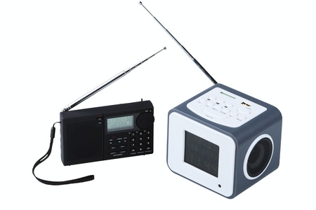 cardreader: Portable radio receivers with alarm, card-reader, amplifier,  remote control and MP3 player isolated on a white background