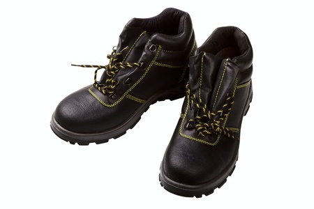 Working boots of black color with a yellow line isolated on a white background