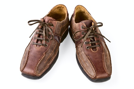 Brown leather mans shoes on a white background Фото со стока