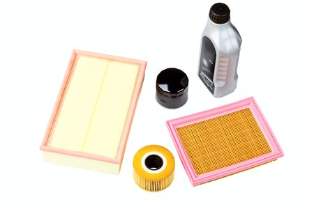 Automobile oil, air and oil filters isolated on a white background Stock Photo - 13717552