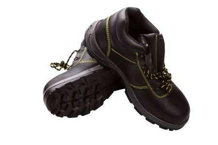yellow line: Working boots of black color with a yellow line isolated on a white background