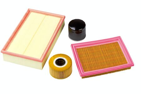 Automobile oil and air filters isolated on a white background