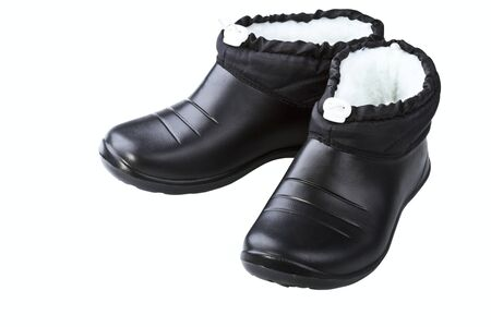 Black rubber female shoes on a white background Stock Photo - 17006529