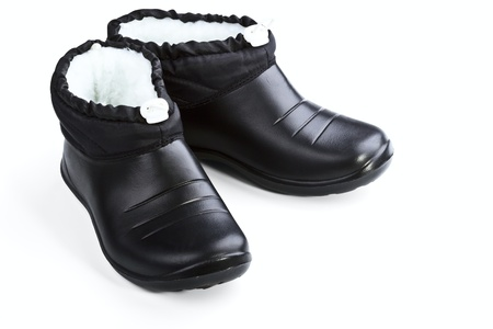 Black rubber female shoes on a white background Stock Photo