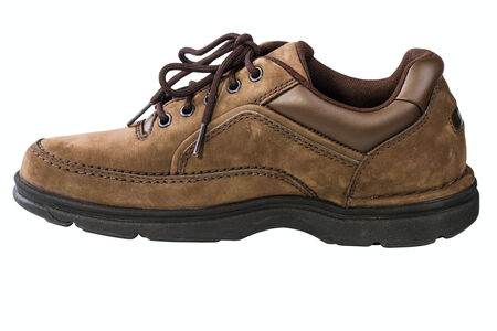 rubber lining: Brown leather mans shoe isolated on white background