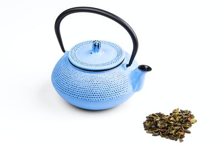 tetsubin: blue pig-iron teapot and green tea isolated on white background Stock Photo