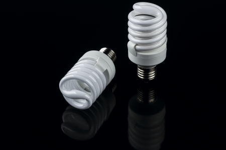 energy smart spiral light bulb isolated on black background photo