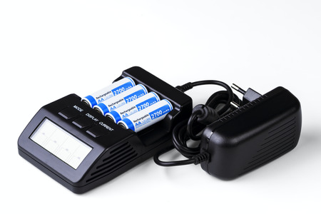smart charger with 4 batteries isolated on white background photo