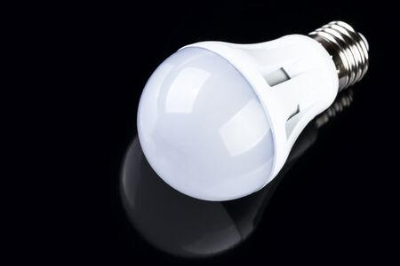 LED bulb isolated on black background photo