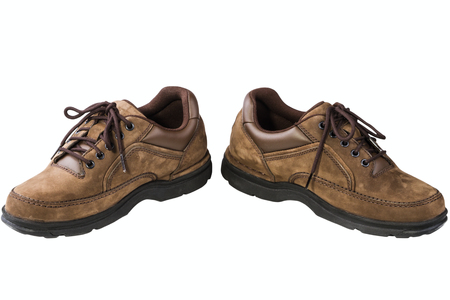 Brown leather mans shoes isolated on white background photo